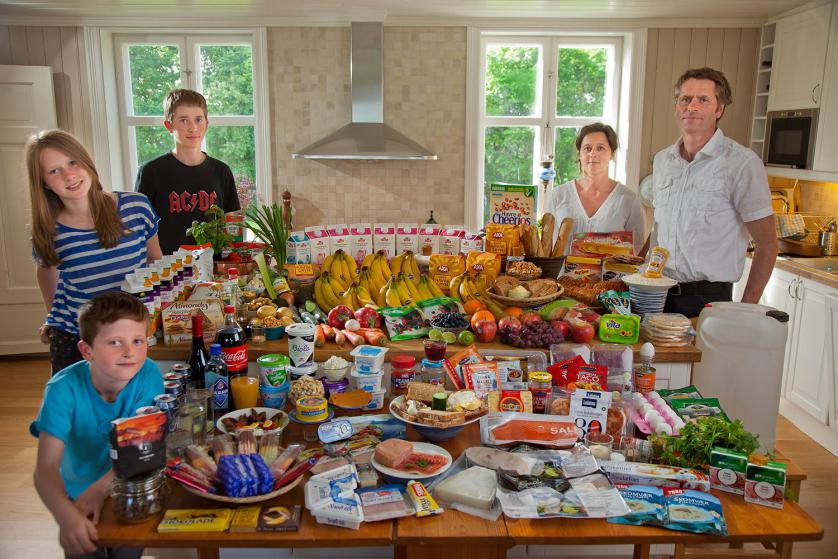 The Glad-Ostensen family in Gjerdrum, Norway. Anne Glad Fredricksen, 45, her husband Anders Ostensen, 48, and their three children, Magnus, 15, Mille 12, and Amund, 8 with their typical week's worth of food in June. Food expenditure for one week: 4265.89 Norwegian Kroner; $731.71 USD. Model-Released.